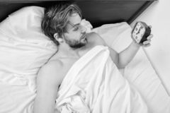 Stick sleep schedule same bedtime and wake up time. Man sleepy drowsy unshaven bearded face covered with blanket having. Rest. Sleep regime habits concept. Man royalty free stock image