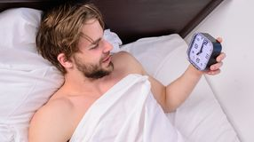 Stick sleep schedule same bedtime and wake up time. Sleep regime habits concept. Man sleepy drowsy unshaven bearded face. Covered with blanket having rest. Man royalty free stock image