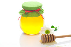 Stick to hohey ,flower  and  jar of honey Stock Photo