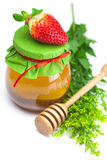 Stick to hohey,strawberries and jar of honey Royalty Free Stock Photography