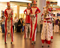 Stick Walkers Band. Stick walker band performing in a mall, Stilts are poles, posts or pillars used to allow the person to stand at a height above the ground Stock Photos