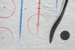 A stick, a washer and a fragment of a hockey arena with markings. Stick, washer and hockey arena with markings. Concept, hockey, background stock photo