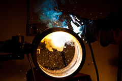 Stick welding. A craftsman stick welding pipe Stock Image