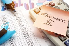 Stick with word finance and business documents. Memo Stick with word finance and business documents Stock Photos