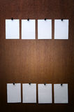 Sticker. S, 8 white papers on wood Stock Images