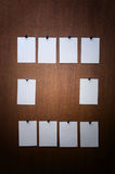 Sticker. White stickers (papers, photos) on wood Royalty Free Stock Images