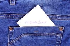 Sticker in back pocket blue jeans Stock Image