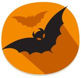 Sticker with bat. Orange and black halloween sticker. Orange halloween sticker with flying bats. Halloween theme clean design Stock Photo