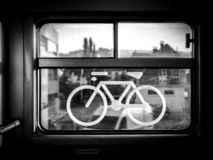 Sticker of a bike on a train window. Captured in a swiss regional train. the place where bike may be stored in trains stock photos