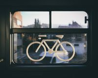 Sticker of a bike on a train window. Captured in a swiss regional train. the place where bike may be stored in trains stock images