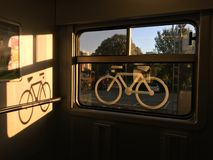 Sticker of a bike on a train window. Captured in a swiss regional train. the place where bike may be stored in trains royalty free stock image