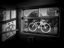 Sticker of a bike on a train window. Captured in a swiss regional train. the place where bike may be stored in trains royalty free stock images