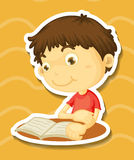 Sticker of a boy reading book Stock Photo