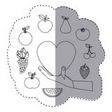 Sticker contour of hand holding a heart with fruits border Stock Photo