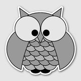 Sticker - cute owl with big squinting eyes Royalty Free Stock Images