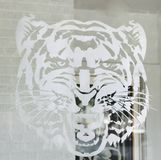 Tiger Sticker. A sticker of a ferocious tiger on a glass window Royalty Free Stock Image
