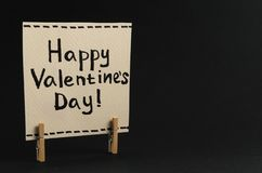 The sticker with the greeting happy Valentines day on the clothespin Stock Photos