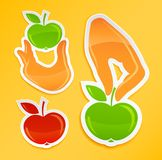 Sticker with hand holding apple Royalty Free Stock Images