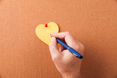 Sticker heart on cork board Stock Photos