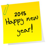 Sticker note with 2015 Happy New Year message. Yelloow sticker note with 2015 Happy New Year message Royalty Free Stock Photography