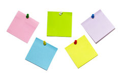 Sticker notes. Five colored sticker notes with push-pins isolated over white background Royalty Free Stock Photos