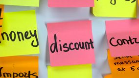 Sticker with the words discount on a board. Sticker pink with the words discount on a white board stock footage