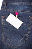 Sticker in pocket jeans Stock Image