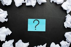sticker with a question mark and around crumpled paper, concept ideas, torment to ideas royalty free stock photo