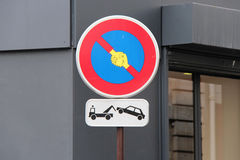 A sticker representing shaking hands was stuck on a road sign in Paris (France) Stock Image