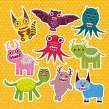 Sticker set Funny monsters collection on Polka dot orange background. Vector Stock Images