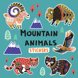 Sticker set with mountain animals. Collection of stickers with mountain animals with ethnic, tribal ornaments. Vector illustration. Set stickers, pins, patches stock illustration