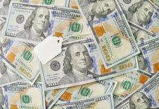 Sticker, spatie op een achtergrond van geld Stock Foto's