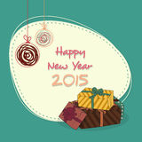 Sticker, tag or label for Happy New Year 2015. Happy New Year 2015 sticker, tag or label design with hanging Xmas balls and colorful gift boxes on green Stock Illustration