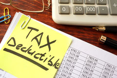 Sticker with title tax deductible. royalty free stock image