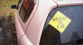 Sticker Woman In Car on the rear glass Royalty Free Stock Photo