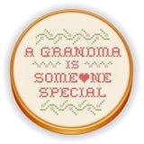 Stickerei, Großmutter-Kreuzstich auf hölzernem Band Stockbilder