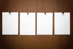 Stickers 2. 4 white papers on wood Stock Images