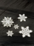 Stickers , Christmas decoration on black.Vertical. Christmas decoration,stickers four snowflakes on black, frosted surface.Vertical view Stock Image