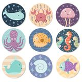 Stickers collection with cute sea animals. Great for baby shower and kids design. Whale, octopus, crab, jellyfish, seahorse, fish and shell. Vector Stock Photos