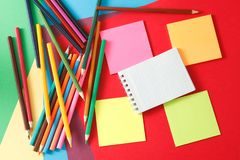 Stickers and pencils. Stickers and colored pencils are on multicolored paper stock photography