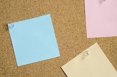 Stickers op de raad Stock Foto's