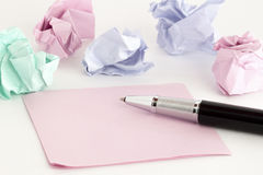 Stickers and pen. Crumpled blue, pink and green stickers and pen Stock Photos