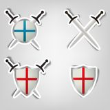 Stickers with a picture of shields and swords. Set of vector stickers with a picture of shields and swords Stock Image