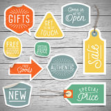 Stickers on rustic wood background for retail Stock Image