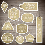 Stickers on rustic wood background Royalty Free Stock Photography