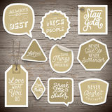 Stickers on rustic wood background Stock Image