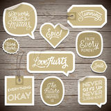 Stickers on rustic wood background Royalty Free Stock Images