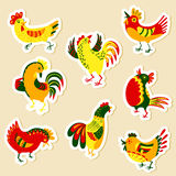 Stickers set with decorative roosters. Isolated farm pets. Carto. On vector birds. Cute chicken characters in doodle style Royalty Free Stock Photography