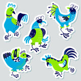 Stickers set with decorative roosters. Isolated farm pets. Carto. On vector birds. Cute chicken characters in doodle style Royalty Free Stock Image