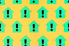 Stickers in the shape of houses on a yellow background. On green sticky notes are drawn exclamation marks. Beautiful. Bright layout. Template Royalty Free Stock Photography